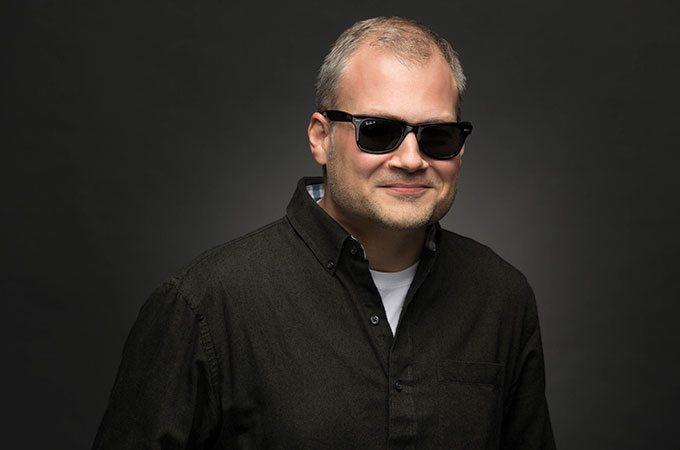 Jon Doss wearing sunglasses