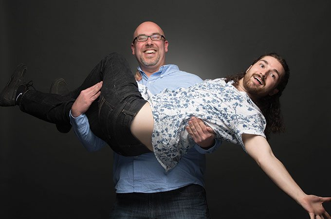 Sublime Media Group puppeteers, David Hosay holding James Kemp like a baby