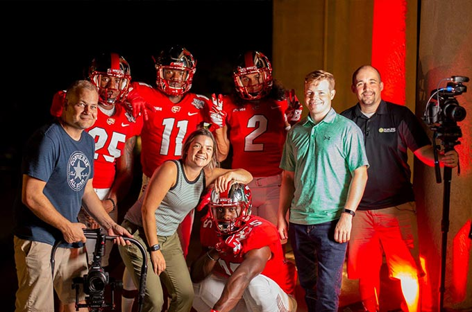 Sublime Media Group team members posed with WKU Football players after a video production shoot