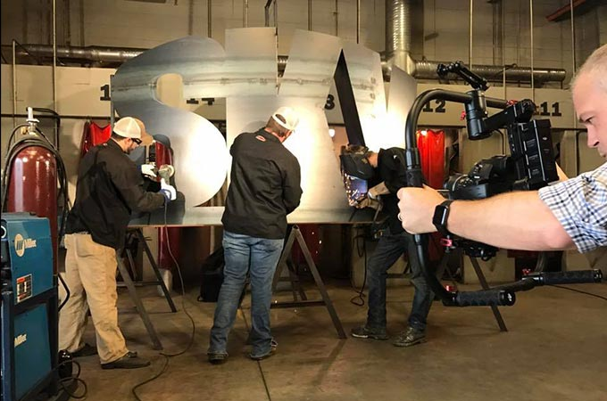 Sublime Media Group video production shoot at SKYCTC photo of metalworking on a sign