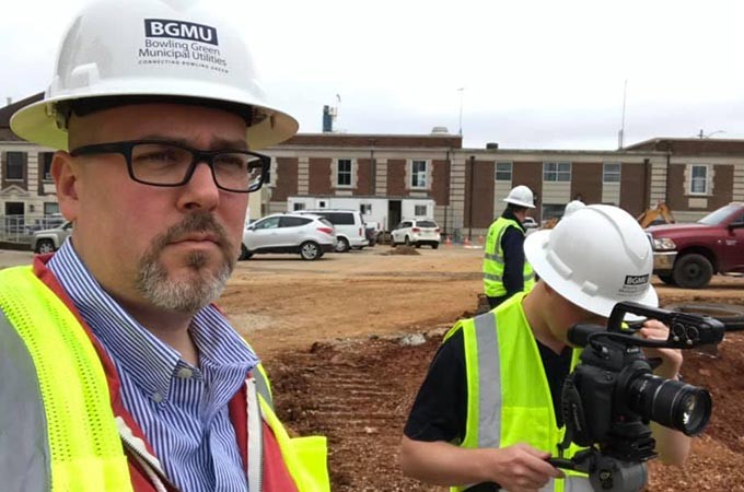 Sublime Media Group Project Manager David Hosay on a video shoot at BGMU work site with videographer Nick Johnson in Bowling Green, Kentucky