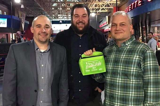 Sublime Media Group Owners Posed at Community Event Grown Up Egg Hunt