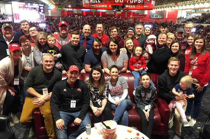 Sublime Media Group family and friends in the hospitality suite at 2019 WKU vs Arkansas Basketball game in Diddle Arena.