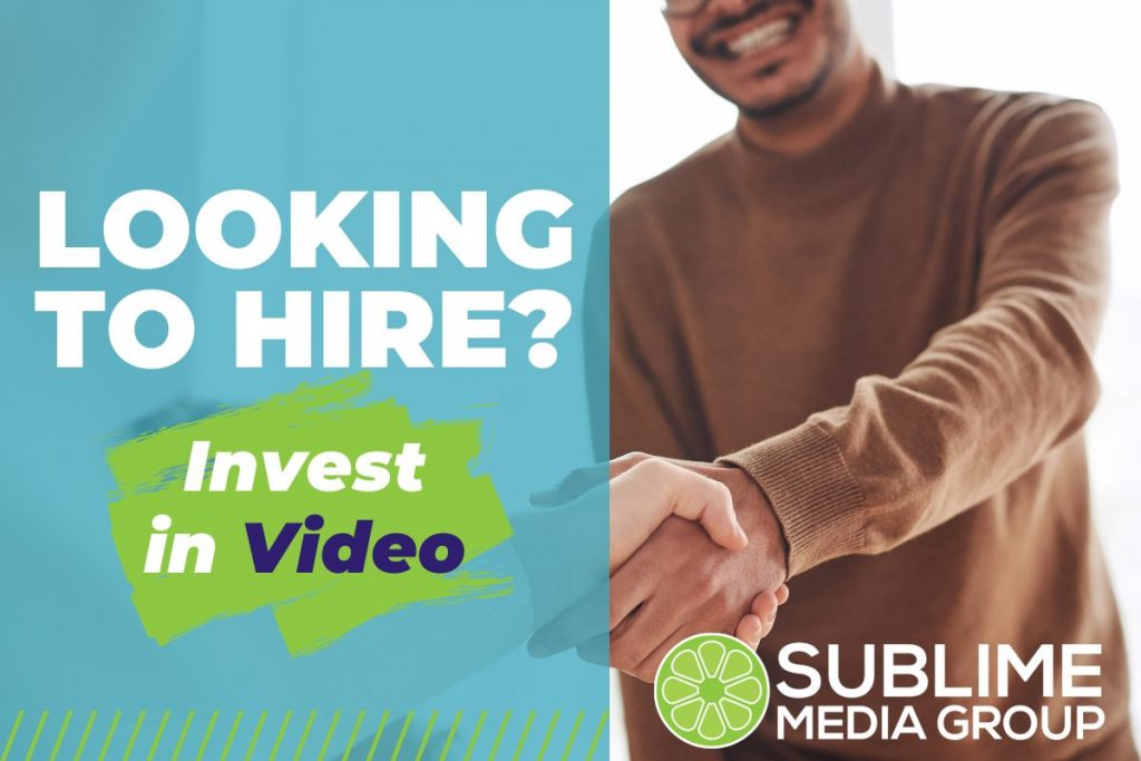 Photo of a man shaking hands without someone else. Text on the image says Looking to hire? Invest in video.