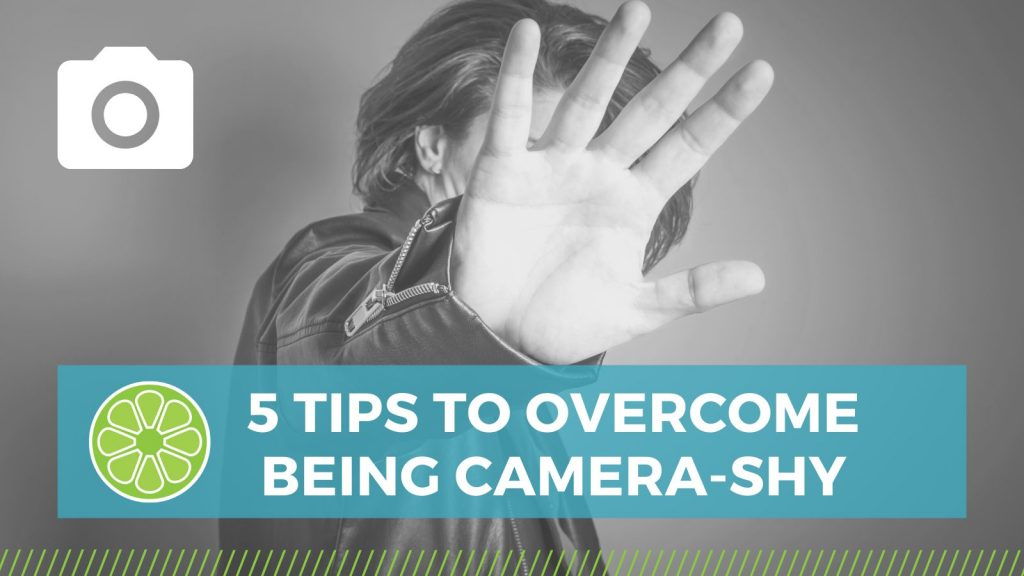 person with hand blocking camera