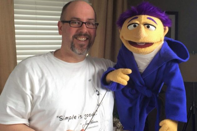 david-holding-puppet-for-the-commercial